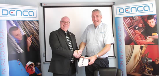 Andy Smith of Endress & Hauser collects his new iPad mini from Denca MD Alan Brennan